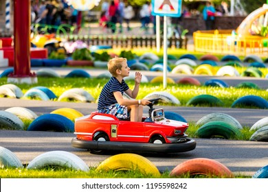 September 2018, Divo Osrtrov amusement park. Saint-Petersburg, Russia. Child in the car on the traffic playground. Educational place for kids to learn about road safety and traffic rules