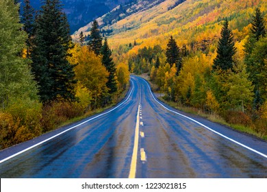 "SEPTEMBER, 2018 - OURAY, SILVERTON COLORADO - Wet autumn road goes from Ouray to Silverton Colorado, the ""Million Dollar Highway"" with color, Route 550"
