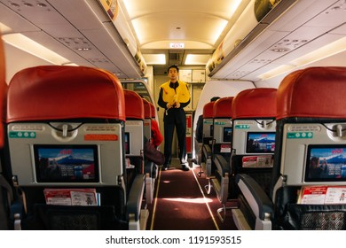 September 2018, Sepang Malaysia - A steward of Air Asia, Malaysia's low cost budget airline giving demonstration on safety features of the aircraft