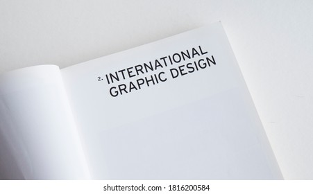 "September 2020 Swansea, UK.  ""International Graphic Design"" Headline Title in Capital Letters on a White Paper Book"