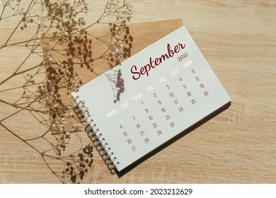 September 2021. Calendar for full month. Notebook for writing on spring next to a sprig of gypsophila flowers. Autumn month. Concept of time planning.