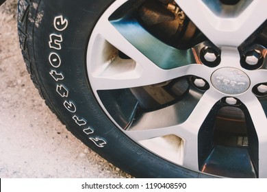 SEPTEMBER 21 2018 - MINNEAPOLIS, MN: Close up view of a Firestone tire on a Jeep Cherokee SUV on a sunny day