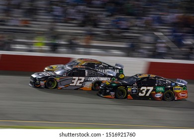 September 21, 2019 - Richmond, Virginia, USA: Corey LaJoie (32) battles for position under the lights for the Federated Auto Parts 400 at Richmond Raceway in Richmond, Virginia.