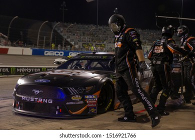 September 21, 2019 - Richmond, Virginia, USA: Corey LaJoie (32) and crew make a pit stop under the lights for the Federated Auto Parts 400 at Richmond Raceway in Richmond, Virginia.