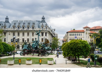 """September 22, 2017 Bucharest/Romania - """"A Carriage with Clowns"""" sculpture by I Bolborea in front of the National Bucharest Theater (TNB); the Bucharest University in the background, Romania"""