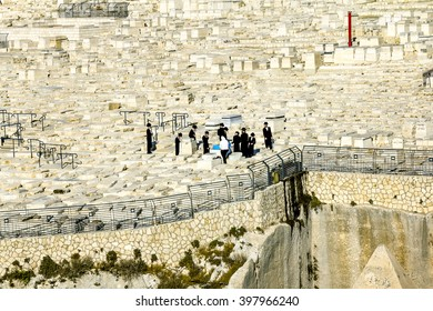 September 23, 2012 .Jerusalem. Jews pray at the graves of the ancestors on the mount of olives to the old city of Jerusalem. Israel.
