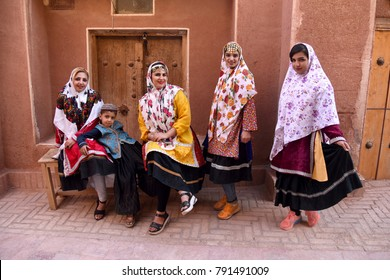 September 23, 2016. Iran. Abyaneh.  Four young Iranian women and teen boy in traditional clothing.  Ancient mountain Iranian village of Abyaneh, near Kashan. The famous settlement of Zoroastrians.