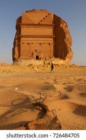 September 23, 2017 - Al-Ula, Saudi Arabia: A Tourist Passes by the tomb Qasir Al-Farid of Madain Saleh or Al-Hijr, a UNESCO World Heritage Site