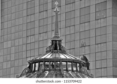 September 23, 2017: A horizontal black and white image of the juxtaposition of old and modern architecture on two buildings on an urban downtown street.