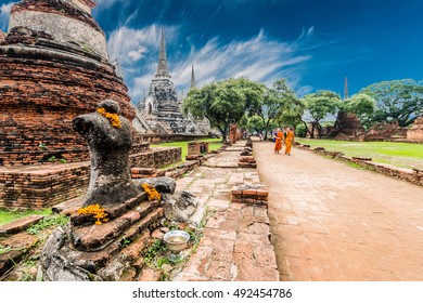 September 24, 2016; the monks walk the ruins at Ayutthaya Historical Park in Thailand.