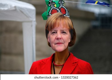 SEPTEMBER 24, 2017 - BERLIN: a mask with the portrait of German Chancellor  Angela Merkelat at demonstration.