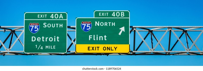 September 25, 2018. Sign. Exit to Downtown Flint, Detroit, Interstate 75, Michigan. USA. Panoramic image.