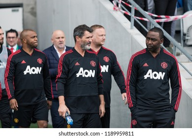 September 25th, 2018, Cork, Ireland - Roy Keane and Andy Cole enter the Pairc Ui Chaoimh pitch for the Liam Miller Tribute match between Ireland and Celtic XI vs Manchester United XI.