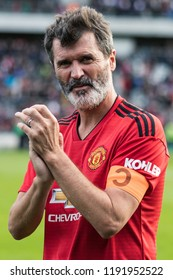 September 25th, 2018, Cork, Ireland - Roy Keane clapping with Manchester United jersey and captain armband on the lap of honor at the Liam Miller Tribute match.