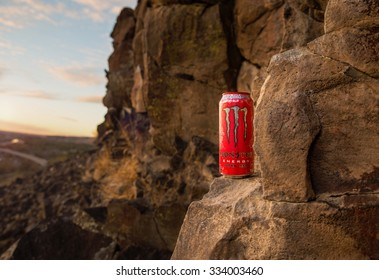 September 26, 2015: Boise, ID A Monster energy beverage positioned on a large rock overlooking the valley from a very popular rock climbing location during sunrise or sunset with a lens flare