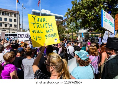 "September 27, 2018 Palo Alto / CA / USA - Rally in support of Christine Blasey Ford in front of the Palo Alto City Hall; ""Your truth will set us free"" raised sign"