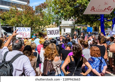 "September 27, 2018 Palo Alto / CA / USA - Rally in support of Christine Blasey Ford in front of the Palo Alto City Hall; Various signs such as ""Kava Nope"" and ""Enough"" raised by participants"