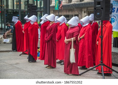 September 27, 2020, Chicago, IL a group of protestors wearing red handmaid\'s tale costumes at a voter drive initiative
