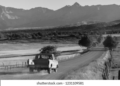 September 28,, 2018, USA - Pickup truck drives County Road 24 near Ridgway Colorado looking towards San Juan Mountains