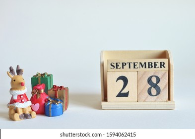 September 28, Christmas, Birthday with number cube design for background.