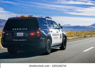 September 29, 2018 Lee Vining / CA / USA - Mono County Sheriff Police car driving on highway 395, Eastern Sierra mountains