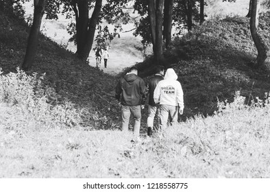September 29, 2018 Minsk Belarus Quest on the sights of Belarus A group of people are walking along the path among the trees in the park.