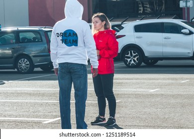 September 29, 2018 Minsk Belarus Quest on the sights of Belarus Man and woman are standing near the car on the street