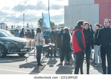 September 29, 2018 Minsk Belarus Quest on the sights of Belarus A group of people stand in the square near the cars.