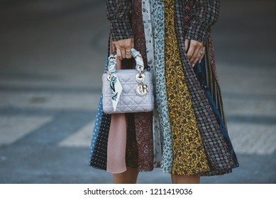 September 29, 2018: Paris, France - Girl wearing a stylish Dior hand bag after a fashion show during Paris Fashion Week  - PFWSS19