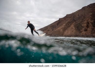 September 29,2019: surfer riding waves on the island of fuerteventura