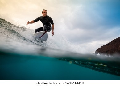 September 29,2019: Surfer riding waves on the island of fuerteventura in the Atlantic Ocean, Canary Islands
