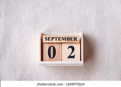 September 2nd. Image of September 2 wooden color calendar  on white canvas background. empty space for text