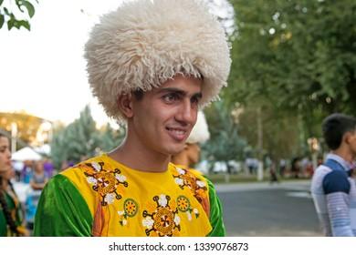 September, 3, 2017. Ashgabat, Turkmenistan : Smiling young man in in national costume before the performance at the Kurban-Bairam Festival. September, 3, 2017. Ashgabat