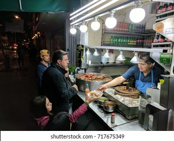 September 3, 2017 - Mexico City, Mexico: Customers line up late at night to order tacos from a vendor in the historical downtown of Mexico City.