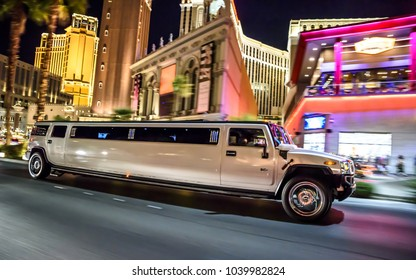 September 30, 2016 - Limousine car moving through night city with lights. Luxury sedan town car going through the city. Night driving on the road in Las Vegas, Nevada, USA.