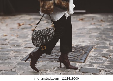 September 30, 2018: Paris, France - Girl wearing a stylish Dior hand bag after a fashion show during Paris Fashion Week  - PFWSS19