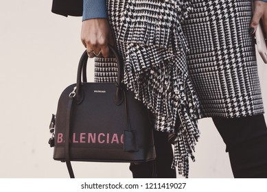 September 30, 2018: Paris, France - Girl wearing a stylish Balenciaga hand bag after a fashion show during Paris Fashion Week  - PFWSS19