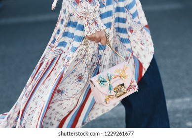 September 30, 2018: Paris, France - Girl with a fancy Furla hand bag during Paris Fashion Week - street style concept - PFWSS19