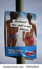 "SEPTEMBER 4, 2017 - BERLIN: an election poster of the right wing populist party ""AFD"" ""Alternative fuer Deutschland"") (Al.ternative for Germany) - showing westerm as opposed to muslim lifestyles."
