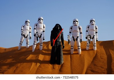 September 4, 2017 - Kingdom of Saudi Arabia: Hasbro Star wars toys First Order Storm Troopers with Kylo Ren shot in a real red sand dunes desert landscape.