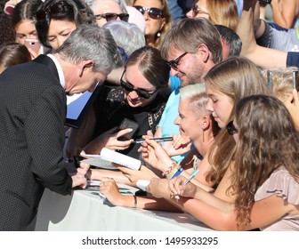 September 4, 2019, Venice, Italy. The 76th Venice Film Festival  at the Lido in Venice, Italy.  Redcarpet for the screening of Babyteeth with Australian actor Ben Mendelsohn signing autographs