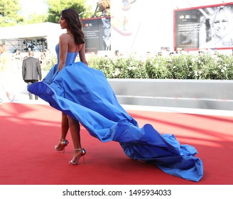 September 4, 2019, Venice, Italy. The 76th Venice Film Festival  at the Lido in Venice, Italy. A guest in a longue blue dress pose on the Redcarpet for the screening of Babyteeth.
