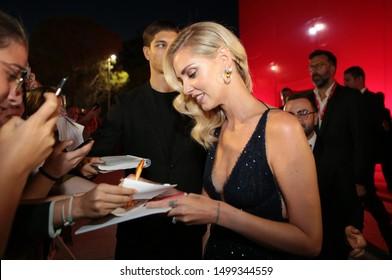 September 4, 2019, Venice, Italy. The 76th Venice Film Festival  at the Lido in Venice, Italy.  Chiara Ferragni with fans