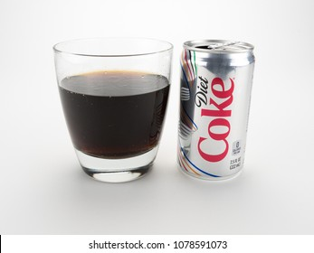September 5, 2016: Conceptual Editorial. A small can of diet soda in a clear glass isolated on white
