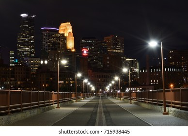 SEPTEMBER 5, 2017 - MINNEAPOLIS, MN : Minneapolis city skyline at night as viewed from the top of the Stone Arch Bridge with no people in Minneapolis, MN on September 5, 2017