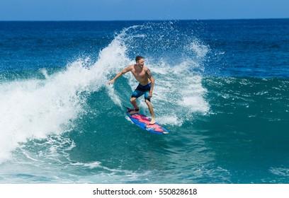 September 6, 2016 - Banzia Pipeline Oahu Hawaii. A surfer rides waves on Oahu's famous surf.