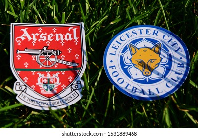 September 6, 2019 London, UK. Emblems of English football clubs rsenal F.C. London  and Leicester City on the green lawn grass.