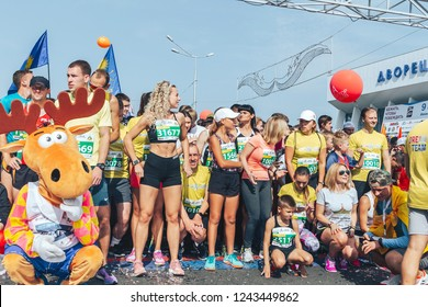 September 9, 2018 Minsk Belarus Half Marathon Minsk 2018 A group of people doing a warm-up on the street before the start