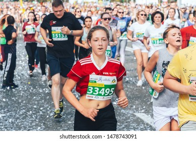 September 9, 2018 Minsk Belarus Half Marathon Minsk 2018 Young girl in a red shirt runs a marathon