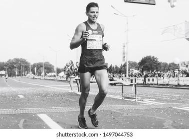 September 9, 2018 Minsk Belarus Half Marathon Minsk 2018 Athlete at the limit of power crosses the finish line at the marathon Black and white image